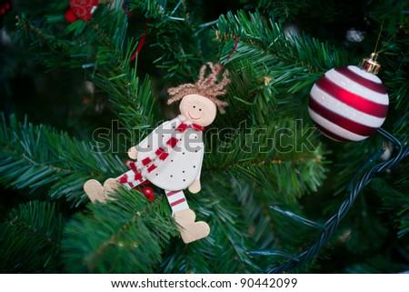 Christmas decorations hung on the Christmas tree - stock photo