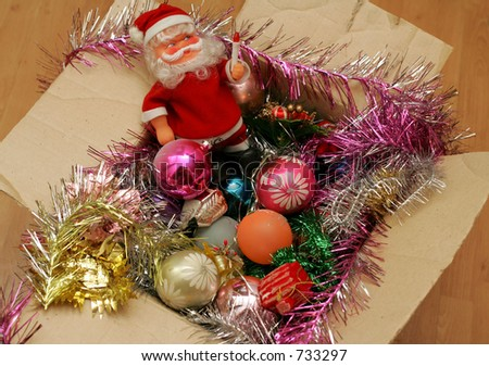 Christmas decorations in a carton  box. - stock photo