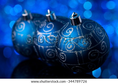 christmas decorations in blue tones - blurred background - stock photo