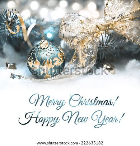 Christmas decorations in cyan and gold, space for your text - stock photo