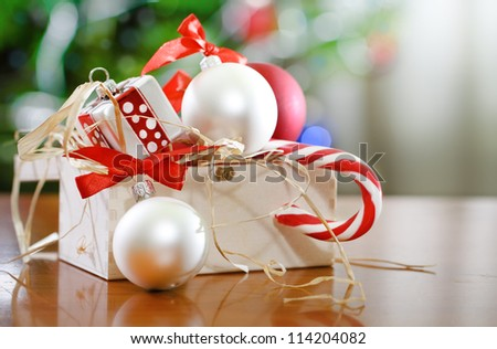 Christmas decorations in front of Christmas tree for the holidays - stock photo