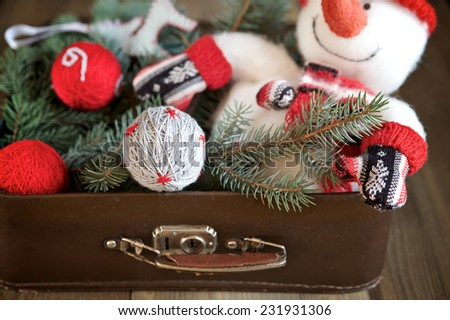 Christmas decorations in old suitcase, selective focus - stock photo