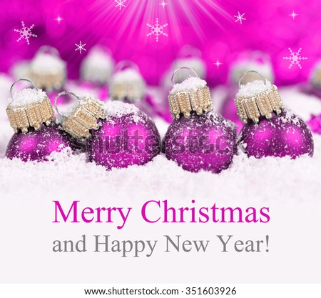 Christmas decorations in snow on defocused lights background. Merry Christmas Card. - stock photo