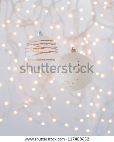 Christmas decorations in the form of white with gold balls on the background of an abstract background - bokeh. - stock photo