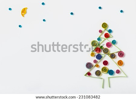 Christmas decorations made of paper quilling and place for text - stock photo