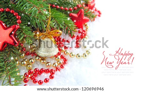Christmas decorations of bauble are with the branches of spruce on snow - stock photo