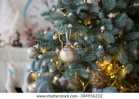 Christmas decorations on a christmas tree - stock photo
