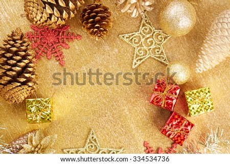 Christmas decorations on a gold background - stock photo