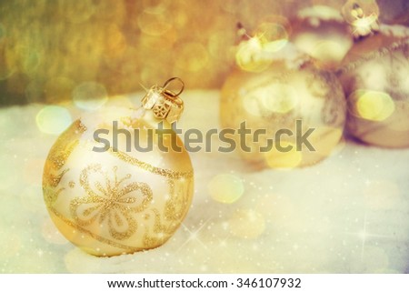 Christmas decorations on a gold background. - stock photo