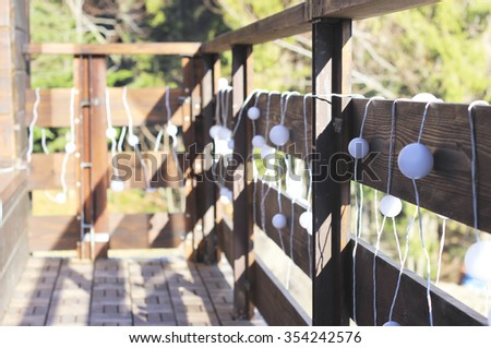 Christmas decorations on a wooden fence, Outside  - stock photo