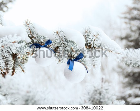 Christmas decorations on fir branch outdoors - stock photo