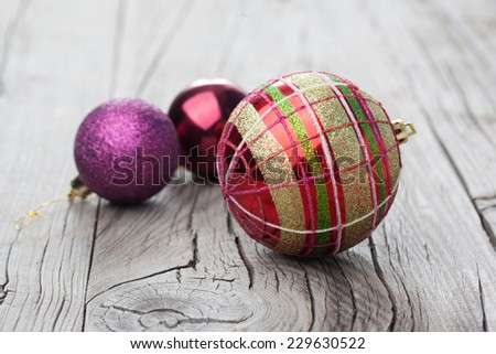 Christmas decorations on old wooden background, selective focus - stock photo