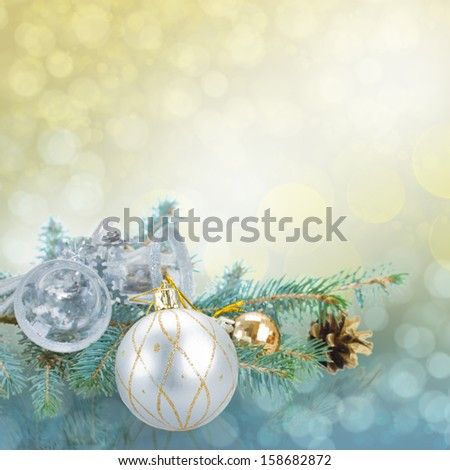 christmas decorations on spruce with blue and golden  sparkles background