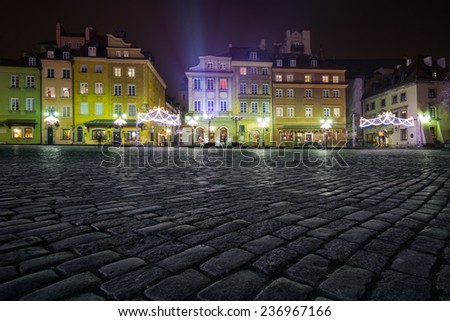 Christmas decorations on the old town of Warsaw at night - stock photo