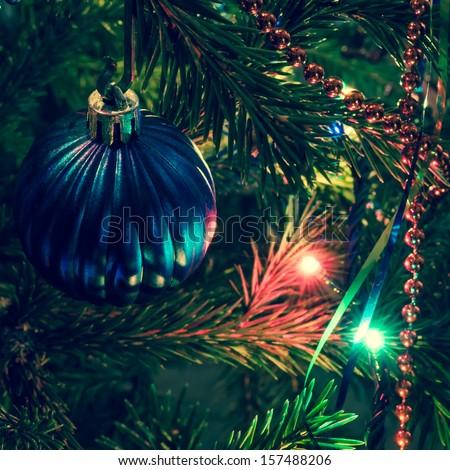 Christmas decorations on xmas tree  - stock photo
