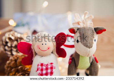 Christmas decorations preparing in winter- angel and donkey. Christmas eve, boxing day. Christmas preparations. Macro. Nobody. Macro. Winter postcard. Santa clause. Christmas tree. - stock photo