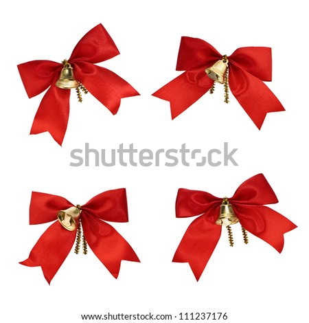 Christmas decorations - red ribbons and bells isolated on white background - stock photo