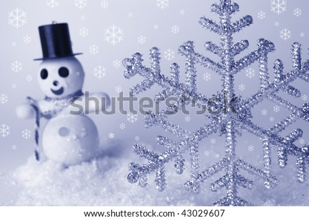 Christmas decorations snowflake and snowman - stock photo