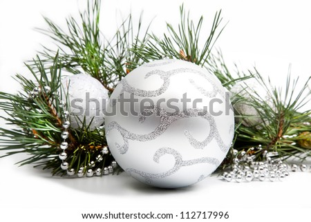Christmas decorations with big silver ball and silver beads on white background - stock photo