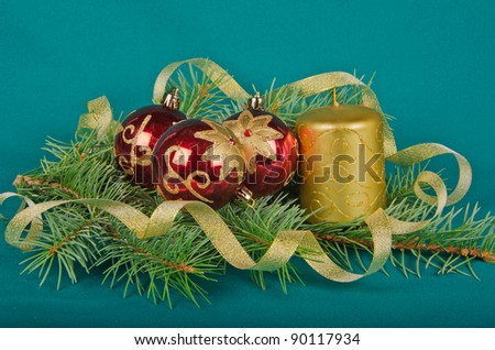 christmas decorations with candle and spruce on green