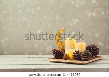 Christmas decorations with candles and pine corn - stock photo