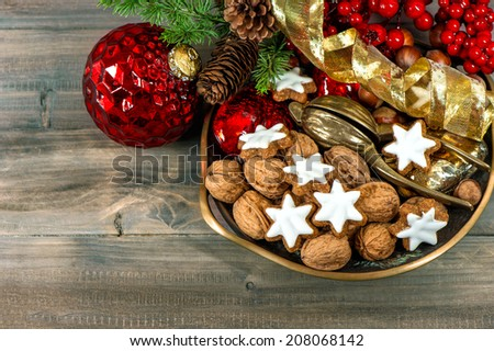 christmas decorations with cinnamon star cookies and walnuts. retro style toned picture