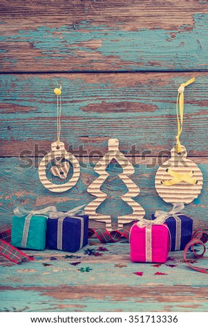Christmas decorations with fir tree, balls and gifts on wooden boards painted in blue. - stock photo