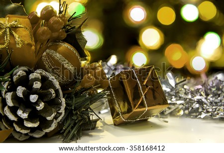 Christmas decorations with out of focus bokeh chrismas tree lights - stock photo