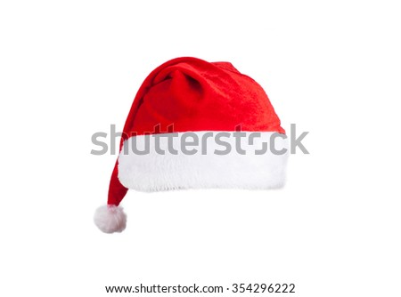 Christmas decorations with santa hat on white - stock photo