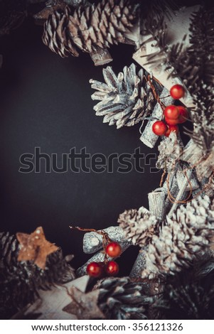 Christmas decorative background top view. Fir tree, Pine cones, and Spruce