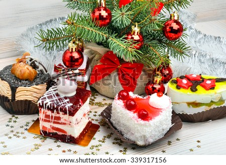 Christmas delicious cakes on christmas background, christmas balls, pine twig.