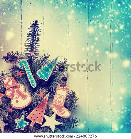 Christmas design - Merry Christmas. Xmas wreath card with copyspace on wooden background. Christmas background with handmaid christmas decorations
