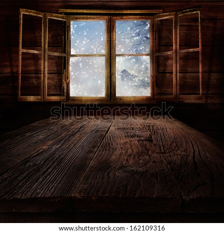 Christmas design - Snowing. Xmas winter background in wooden cabin with snowing nature  and winter landscape in the back. - stock photo