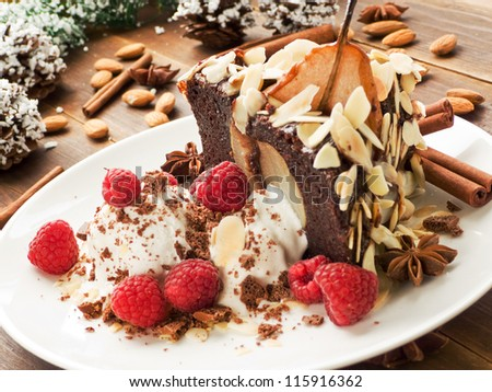 Christmas dessert pear cake with ice-cream and raspberries. Shallow dof. - stock photo
