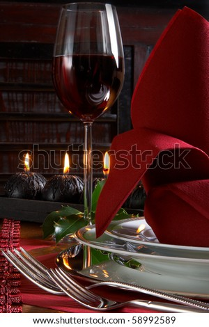 Christmas dinner table detail with red and black accents - stock photo