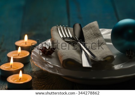 Christmas dinner table. Traditional Christmas decorations. Romantic table setting. - stock photo