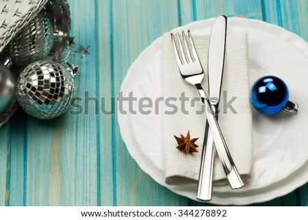 Christmas dinner table. Traditional Christmas decorations. Romantic table setting. - stock photo