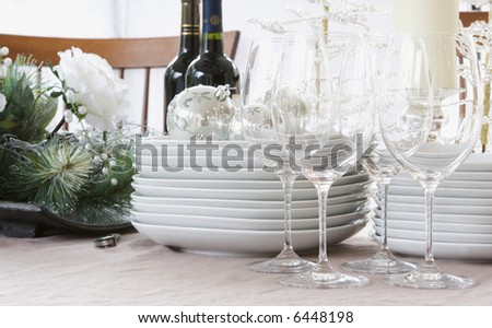 christmas dinner table - white, bright, & modern - stock photo
