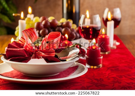 Christmas dishware on the wooden table - stock photo