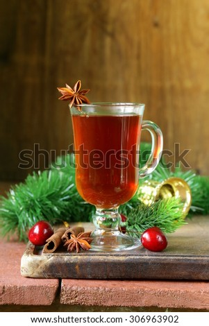 Christmas drink tea with cinnamon and star anise - stock photo