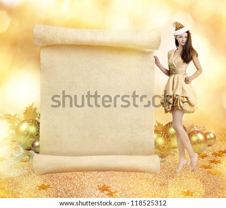 Christmas elf. Young gorgeous women as christmas elf on golden background with blank scroll - stock photo