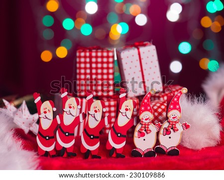 christmas elves, santa and snowman toy with lights background - stock photo