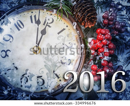 Christmas Eve and New Years at midnight. Clock covered with snow. 2016 new year. - stock photo