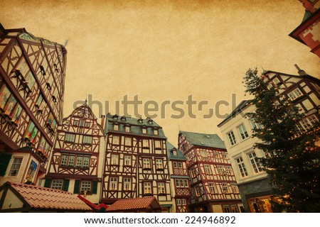 Christmas Eve in Bernkastel-Kues, Germany. Photo in retro style. Added paper texture. - stock photo