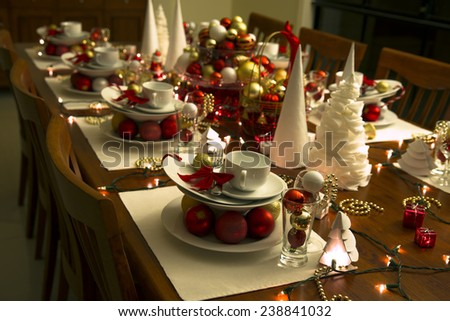 christmas eve table setting with ornaments, new year table setting - stock photo