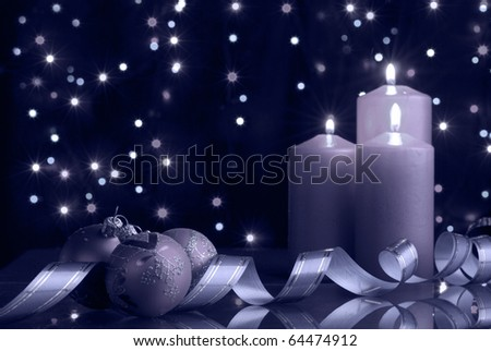 christmas evening blue tone. A composition from candles, New Year's toys on a dark background - stock photo