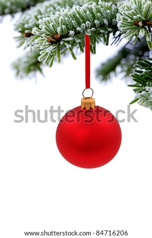 Christmas evergreen spruce tree and red glass ball on snow background - stock photo