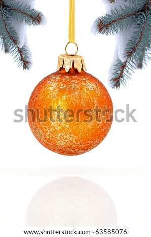 Christmas evergreen spruce tree, glass ball and fresh snow - stock photo