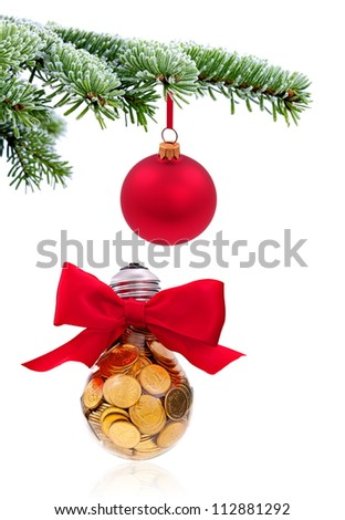 Christmas evergreen spruce tree with traditional lightbulb on snow background