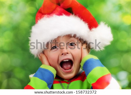 Christmas excitement - ecstatic young boy on christmas morning - stock photo